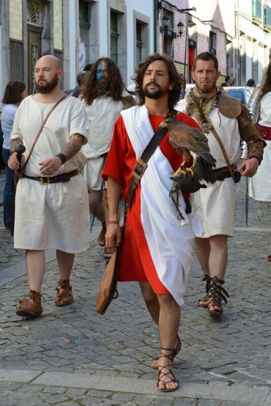 Falcon and Roman gladiators, street procession, Braga Romana, Portugal. Photography by Julie Dawn Fox