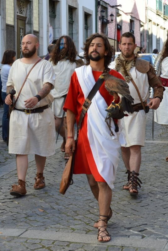 Falcon and Roman gladiators, street procession, Braga Romana, Portugal. Photography by Julie Dawn Fox