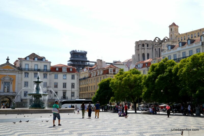 Rossio square in Lisbon with Santa Justa elevator and Carmo church in the background