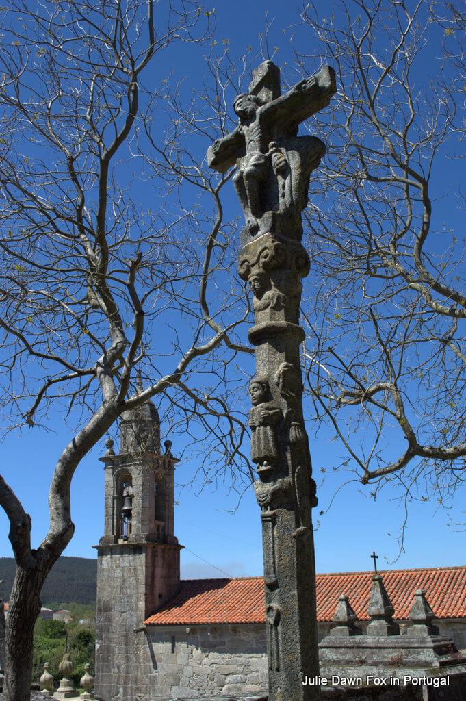 Stone cross outside San Xulian church, Infesta
