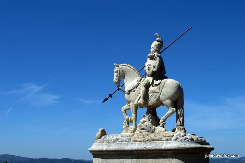 Stone sculpture of knight on horseback with strange shield, Bom Jesus, Braga