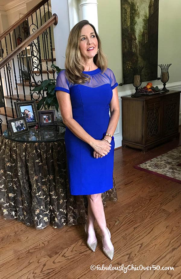 woman in blue cocktail dress