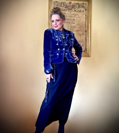 woman in blue velvet jacket