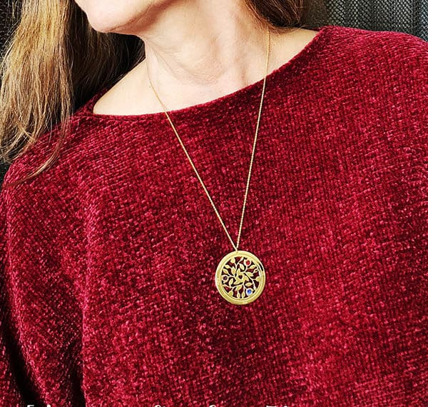 red sweater gold necklace