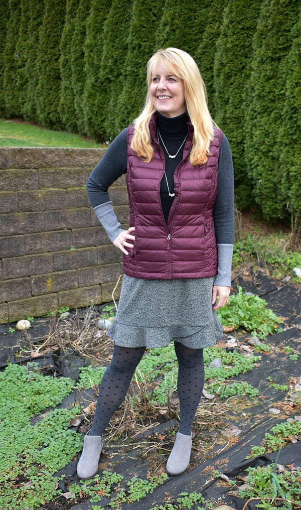 over 50 woman in puffer vest