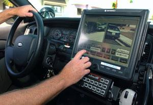 Licensed to Scan: A police officer in Lomita, California operates a license plate reader.