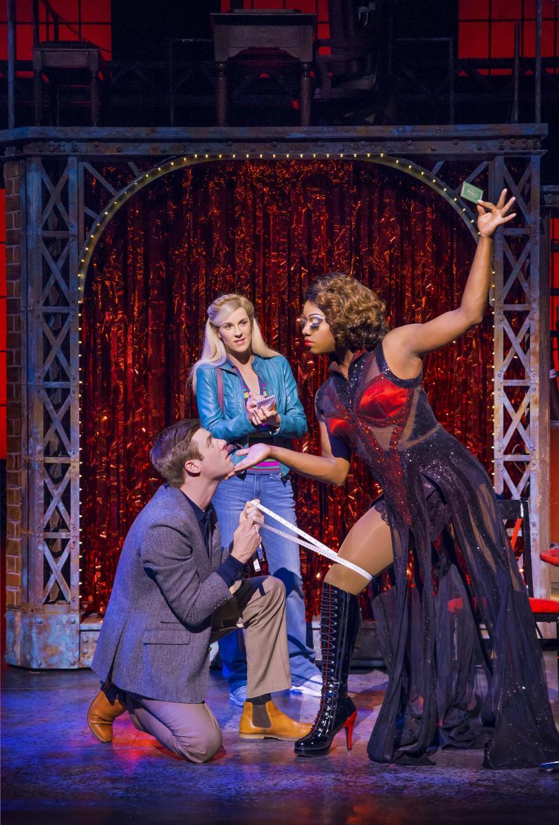 L-R David Hunter (Charlie Price), Verity Rushworth (Lauren) and Simon-Anthony Rhoden (Lola) in Kinky Boots at the Adelphi Theatre, photo by Matt Crockett