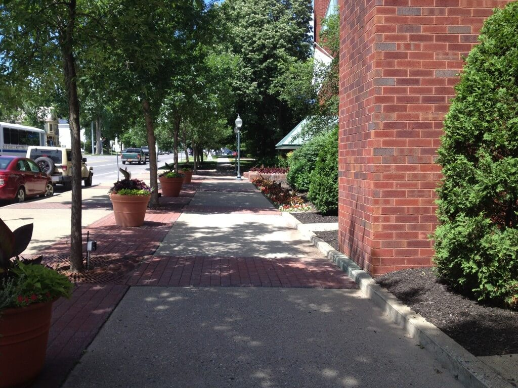 The shaded sidewalks of downtown Saratoga Springs make it the perfect place for a stroll.