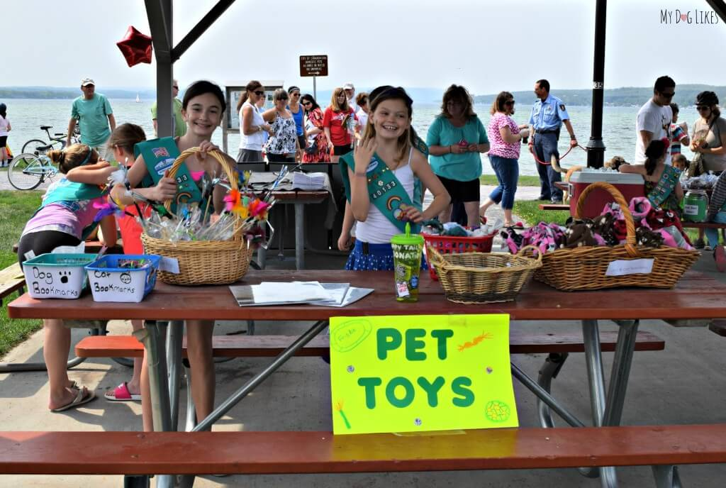 A couple local girl scouts displaying their homemade dog toys!