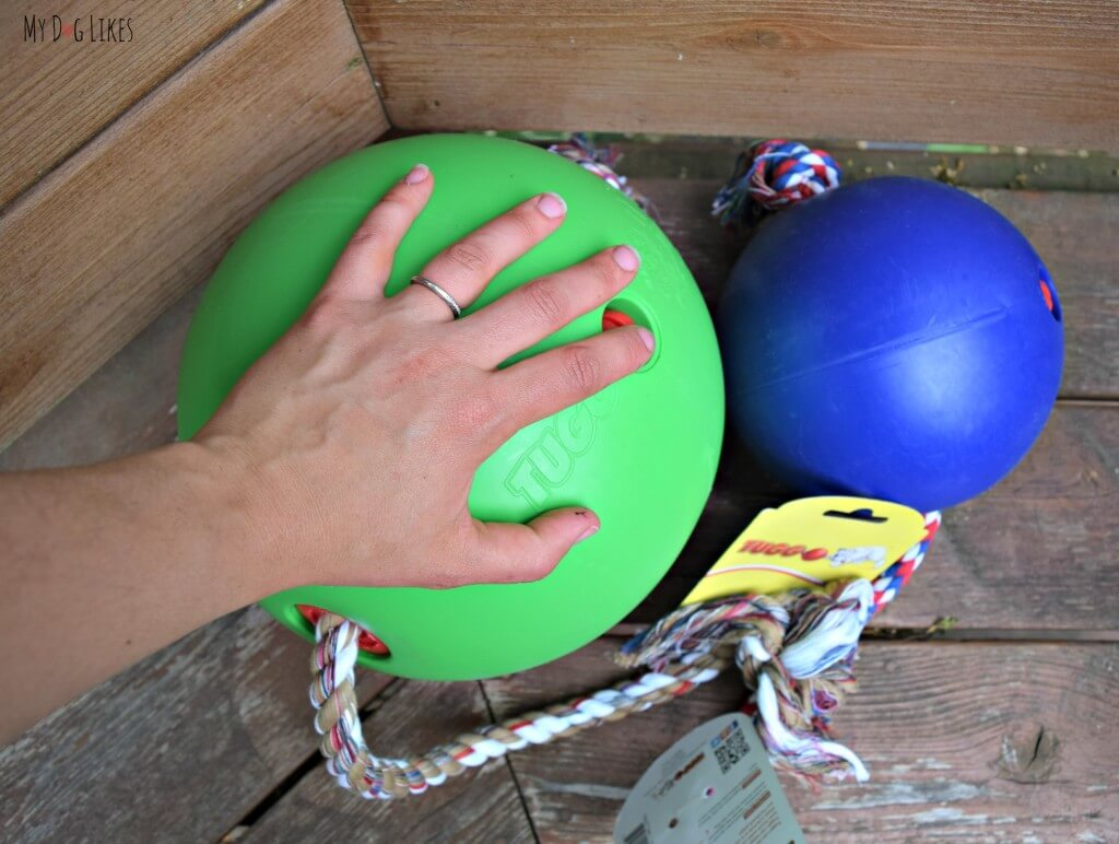 """The large Tuggo is roughly 10"""" in diameter (hand shown for reference). This is an extremely durable dog toy that can withstand even the strongest chewers!"""