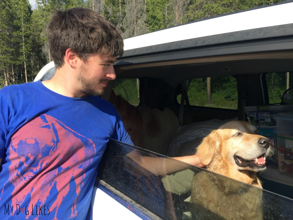 Harley and Charlie admiring the view from the van while riding through Grand Teton National Park.