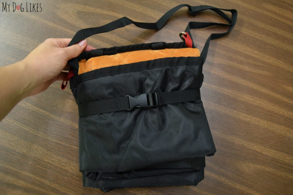 Folds up into a nice package complete with handle/shoulder strap for easy carrying.