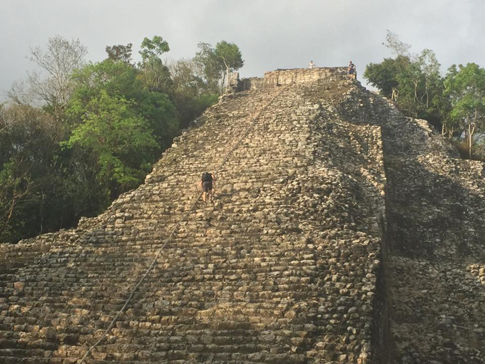 Me climbing the Mayan Ruins of Coba. They're huge!