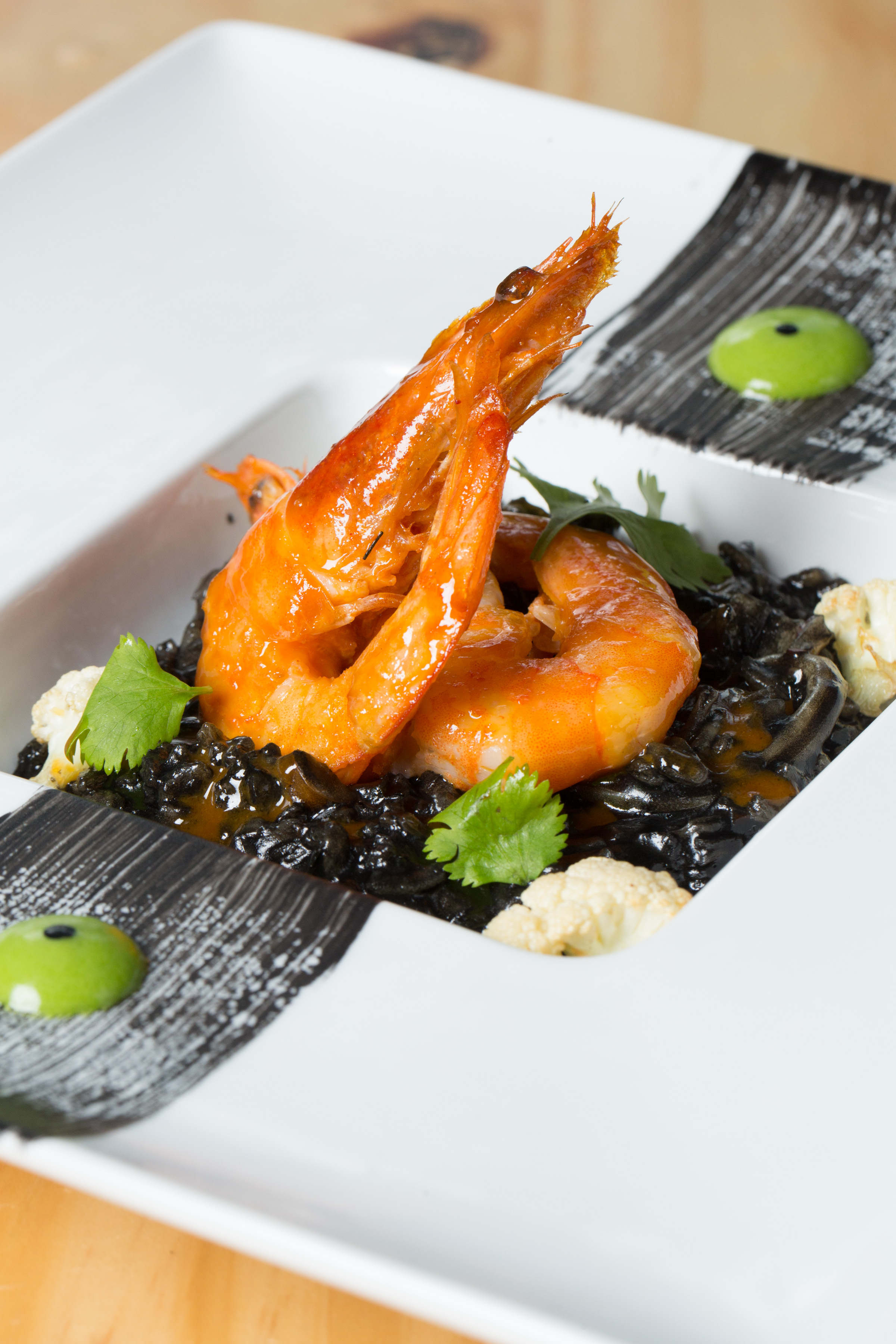 Langoustines with squid ink risotto