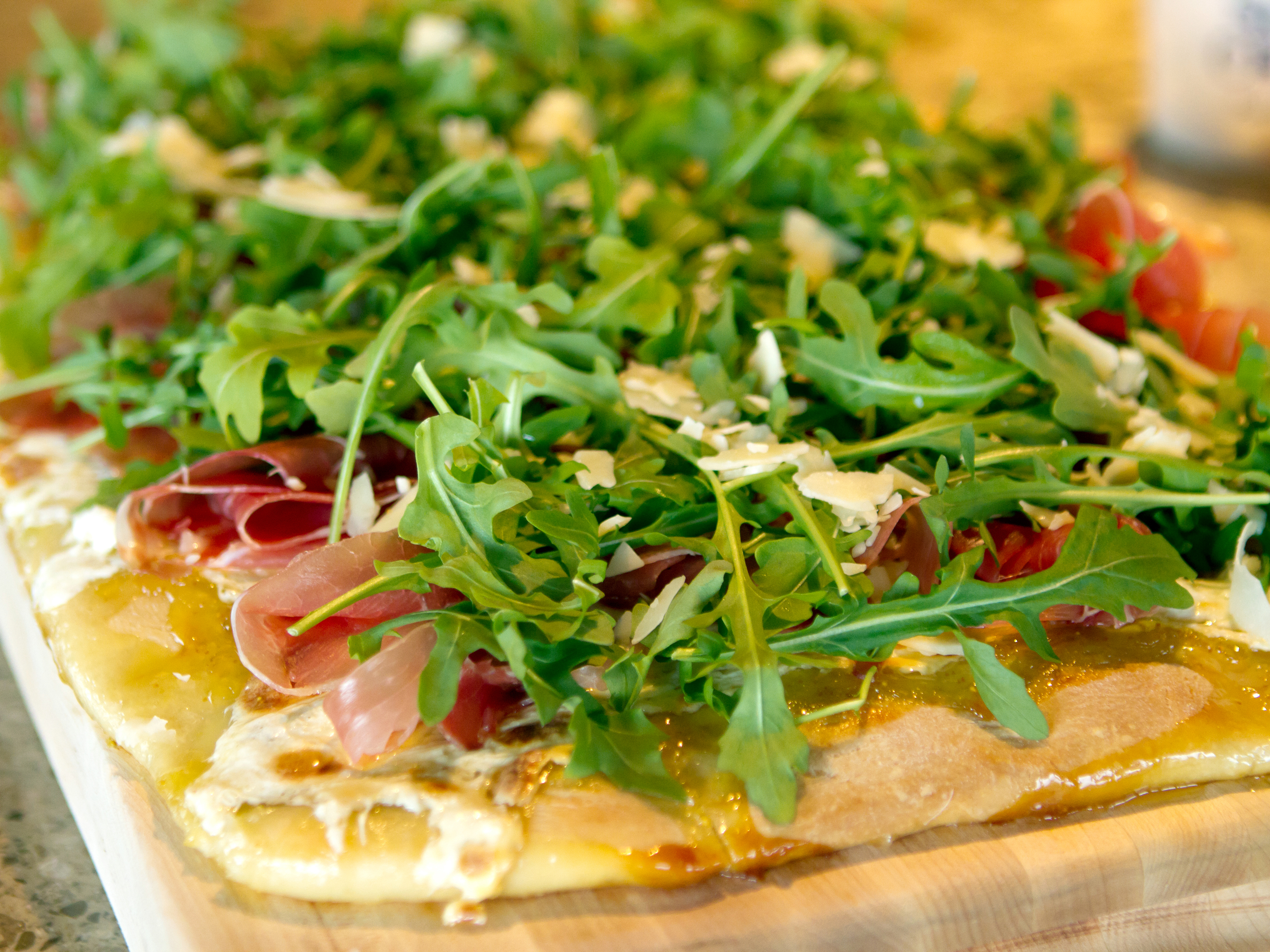 Ree Drummond - host, prepares Fig and Prosciutto Pizza with Arugula during episode 4 as seen on Food Network's Pioneer Woman Season 1.