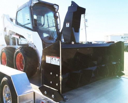 Skid-steer with snowblower attachment from Midsota Manufacturing.