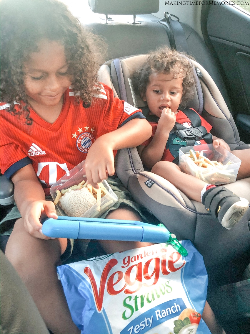 Kids snacking on Veggie Straws in the car