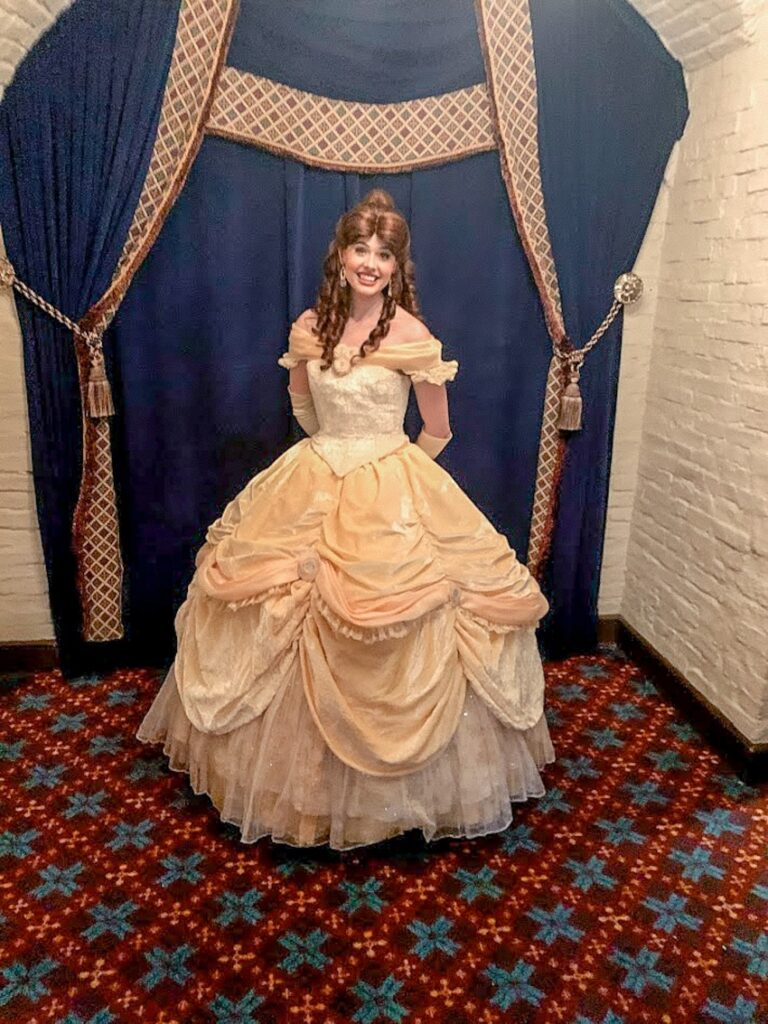Belle Princess Meet and Greet at Disney World, dressed in her classic yellow ball gown