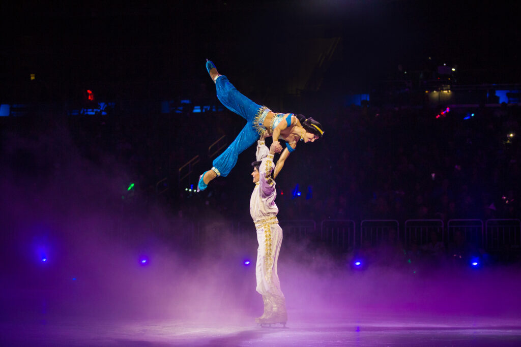 Disney On Ice Mickey's Search Party - Aladdin lifting Jasmine up and over his head