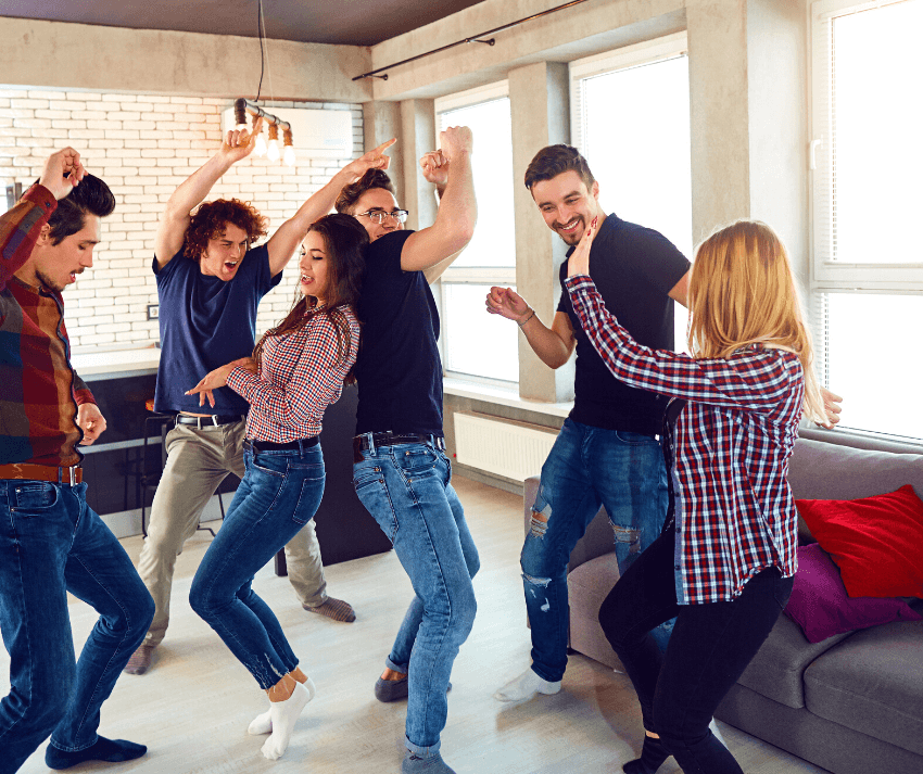 family dancing in their living room