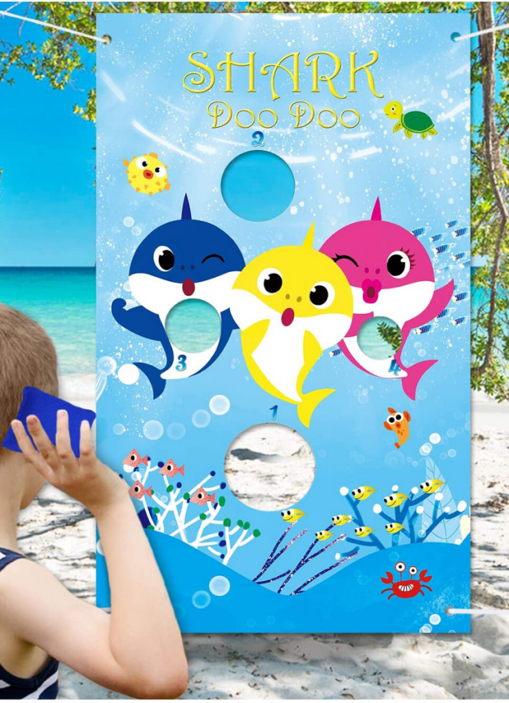 little boy playing the Baby Shark Bean Bag Toss game