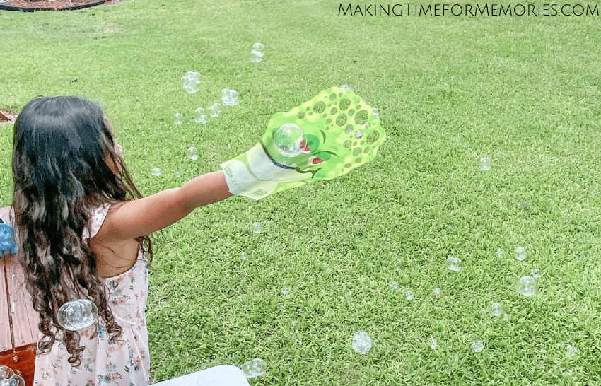 girl making bubbles with a Glove-A-Bubble