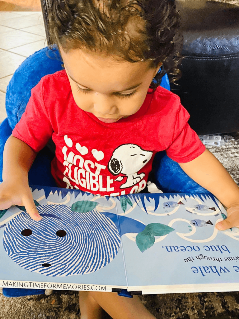 "Toddler looking at ""Alphaprints: Colors"" from Priddy Books Early Learning Collection"