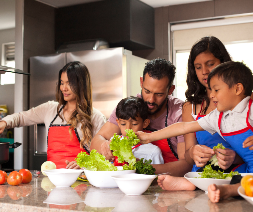 family making a salad together
