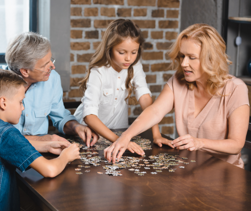 family putting jigsaw puzzle together