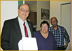 John Anivino, Selectman, Town of Stoughton, delivers Meals on Wheels to OCES Consumers Jose and Francelina Gomes