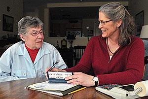 women reviewing checkbook