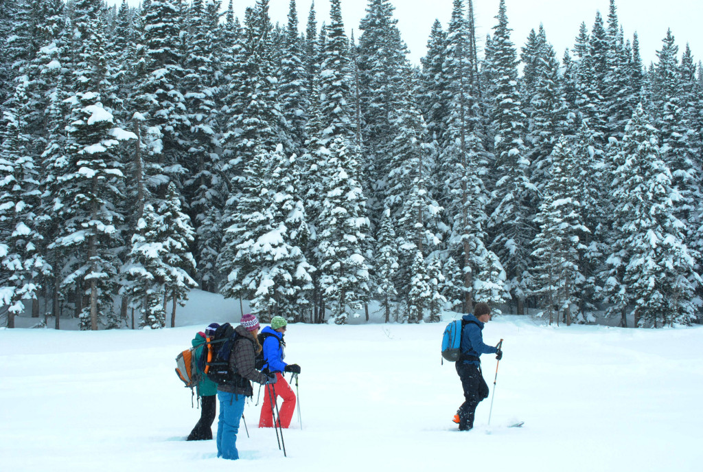 Trekking across Bear Lake in Rocky Mountain National Park while the snow continues to fall