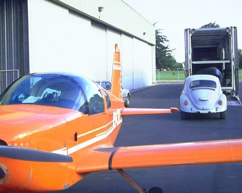 VW Car and Orange Airplane