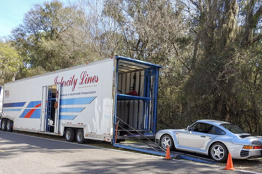 enclosed auto transport service shipping a porsche 959
