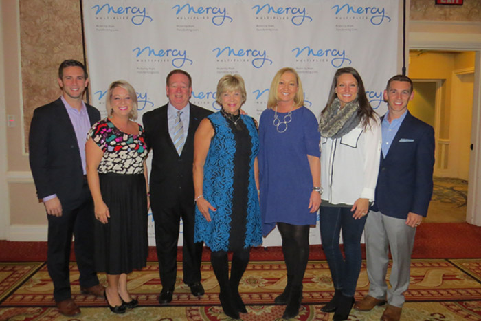 Nancy Alcorn with the Winters family at St. Louis Merry Mercy