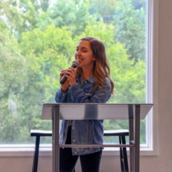 Mercy graduate Catherine Comes speaking to residents of the Nashville home