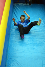 "The old ""bouncy house slide"" was a huge hit at Mission Arlington's Fall Festival."