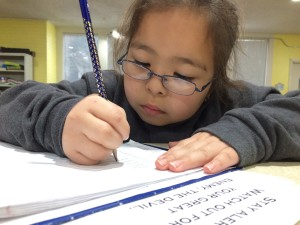 "Working on homework and learning God's word is an important part of Mission Arlington's ""after-school"" programs."