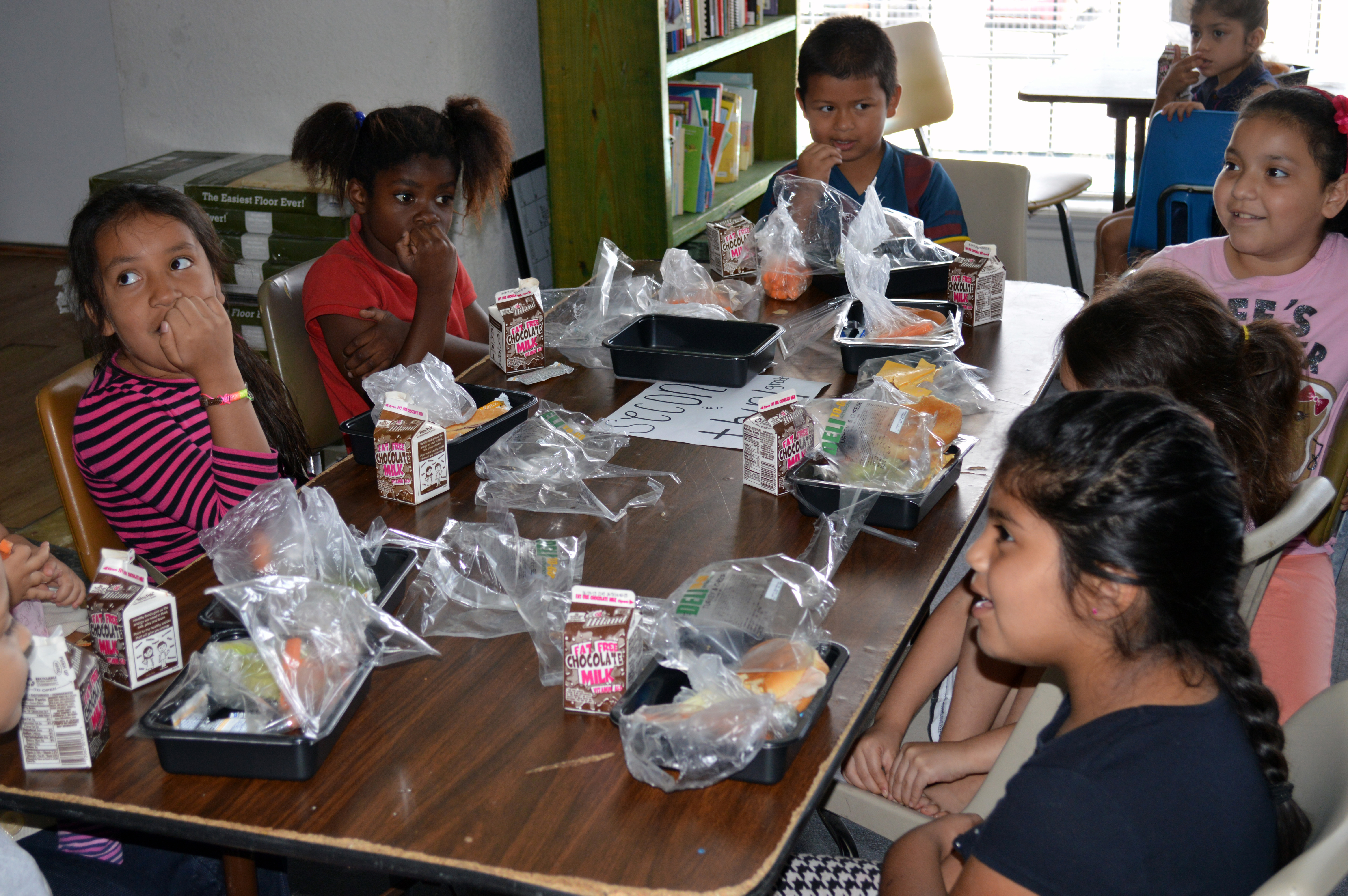 Children eat a nutritious meal, provided with lots of love through Mission Arlington's Summer feeding ministry.