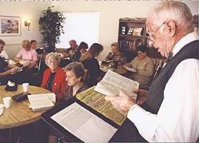 Jack Longgrear, teaching God's Word, in a central Arlington apartment community which he pastored for more than 2 decades. Imogene was the children's ministry leader.
