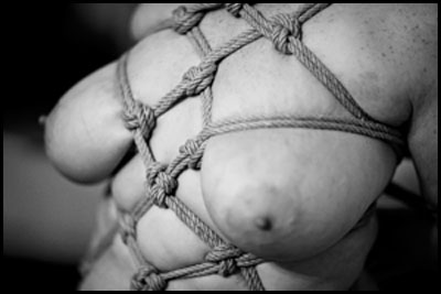 slave judy relaxing in rope