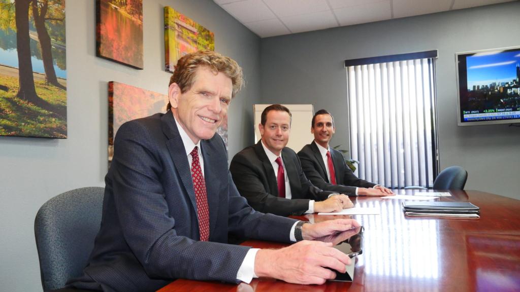 Parker Evans, David Bennett, Joseph Baer sitting at Successful Portfolios conference table.