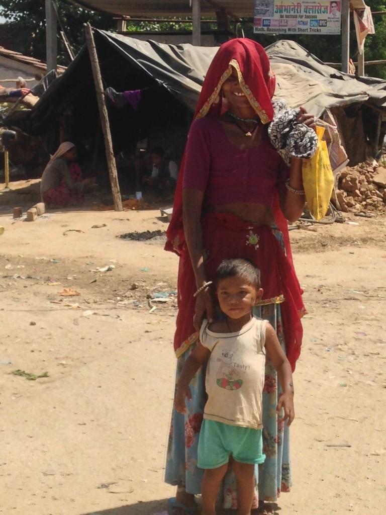 Beautiful sari and grubby child