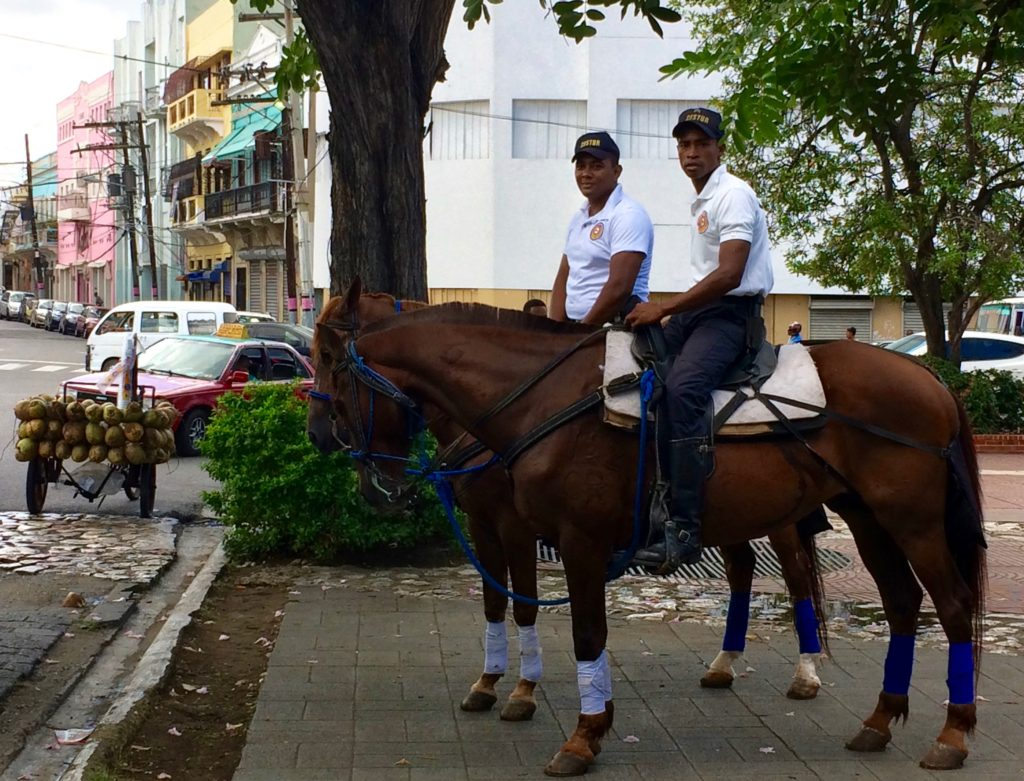 Santo Domingo policemen on horseback with coconut cart