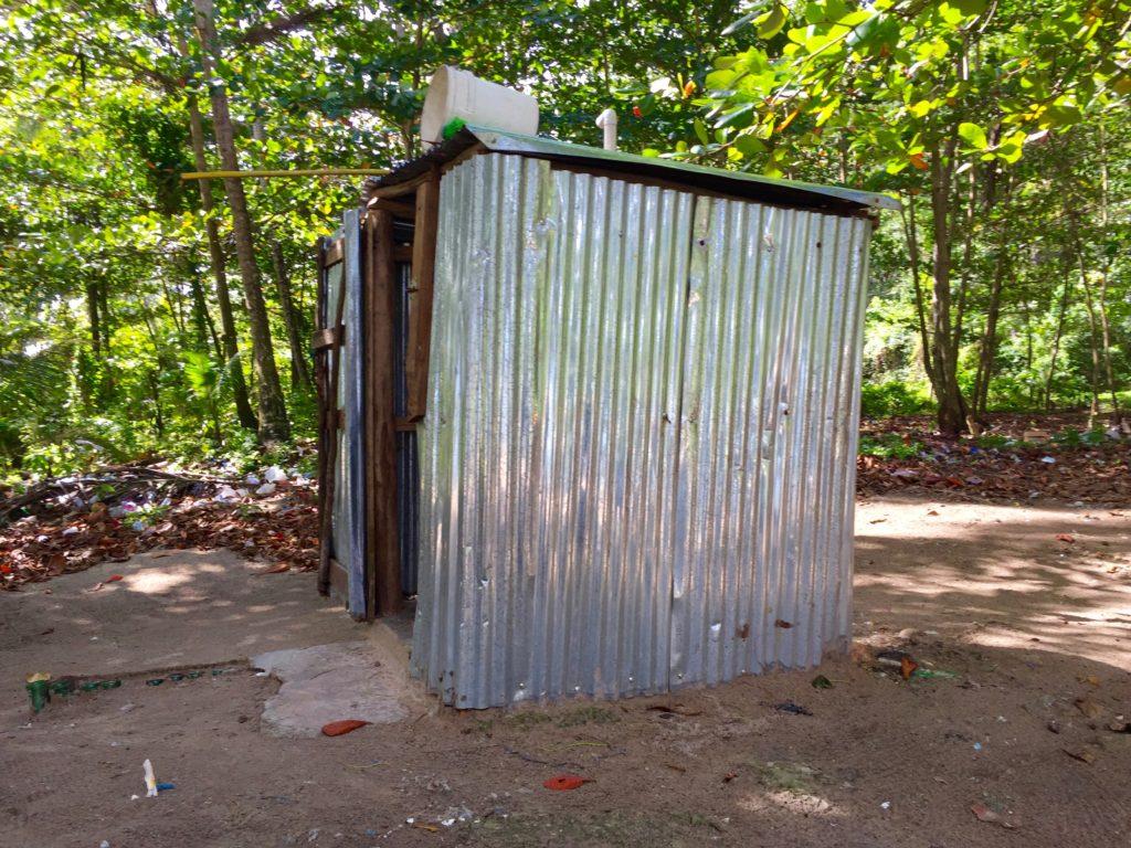 Tin outhouse & trash at Playa Rincon