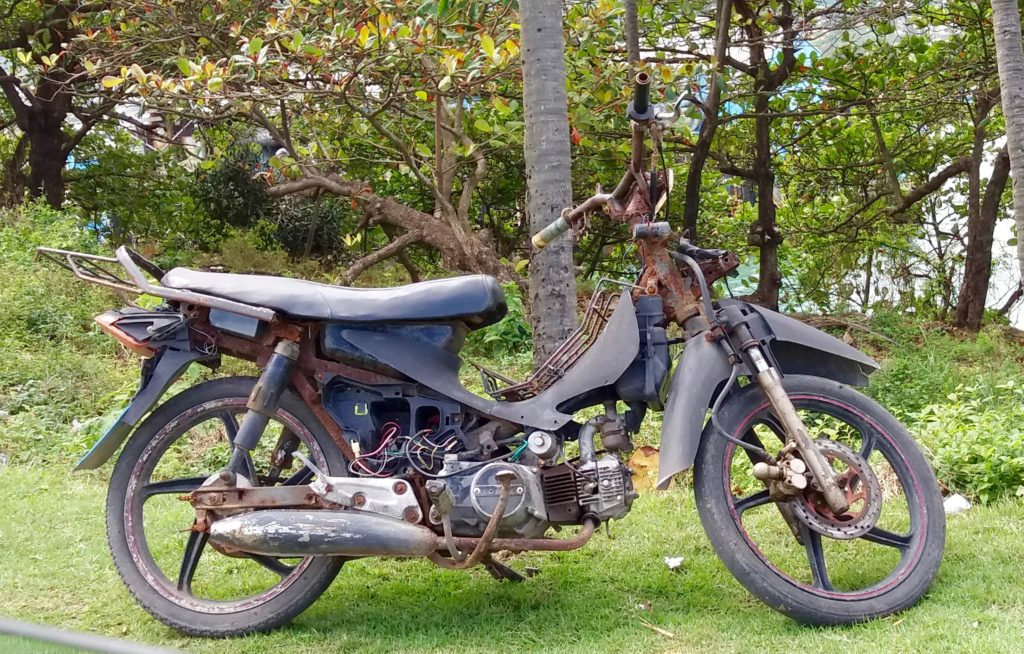 Antique working bike in a city of motoconchos