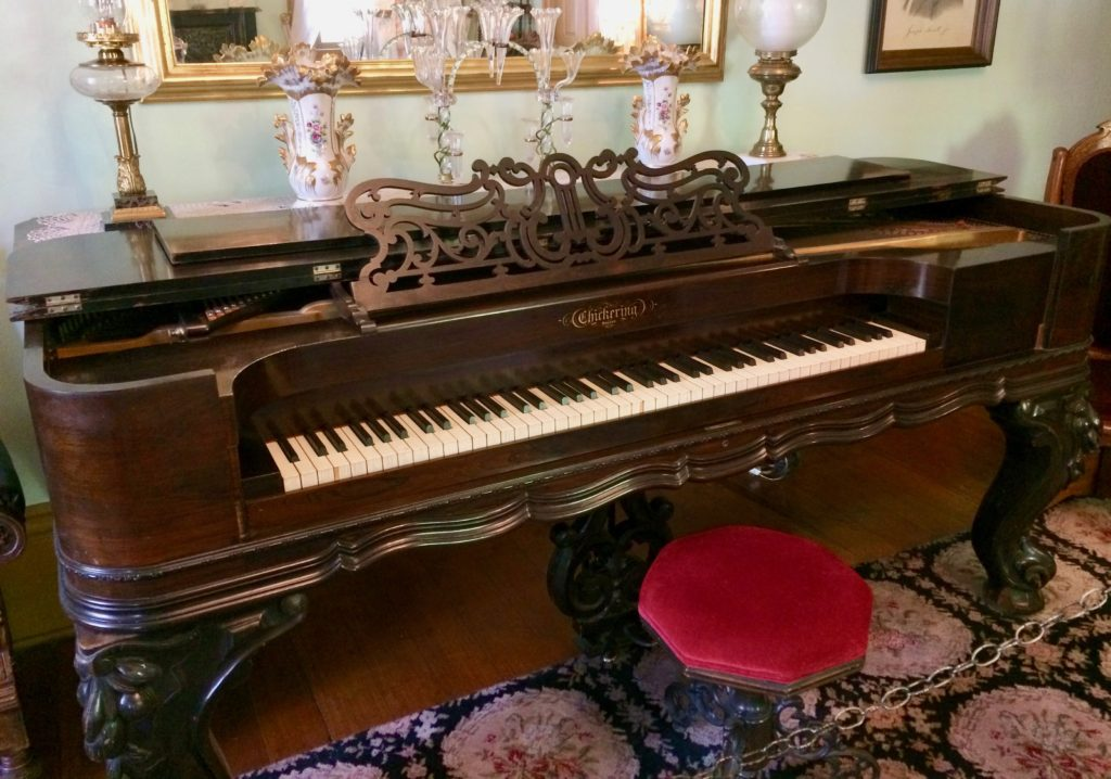 Piano shaped to fit in a wagon