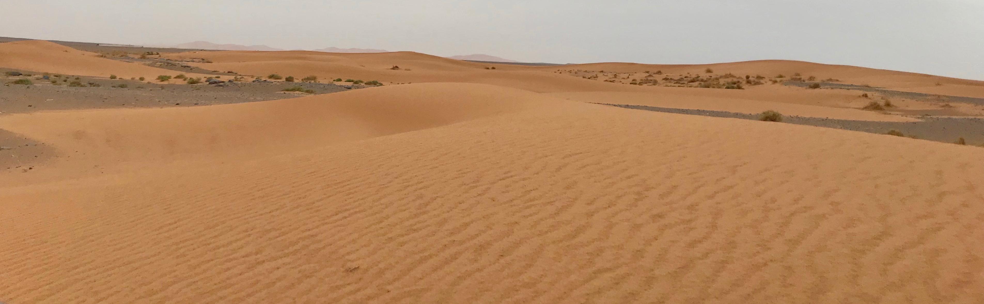 Dunes emerge from gravel base