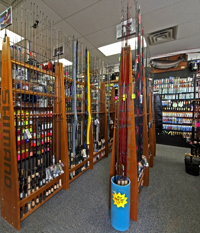 HLS - Store Random Product Pictures Spinning & Baitcast Rod Racks.