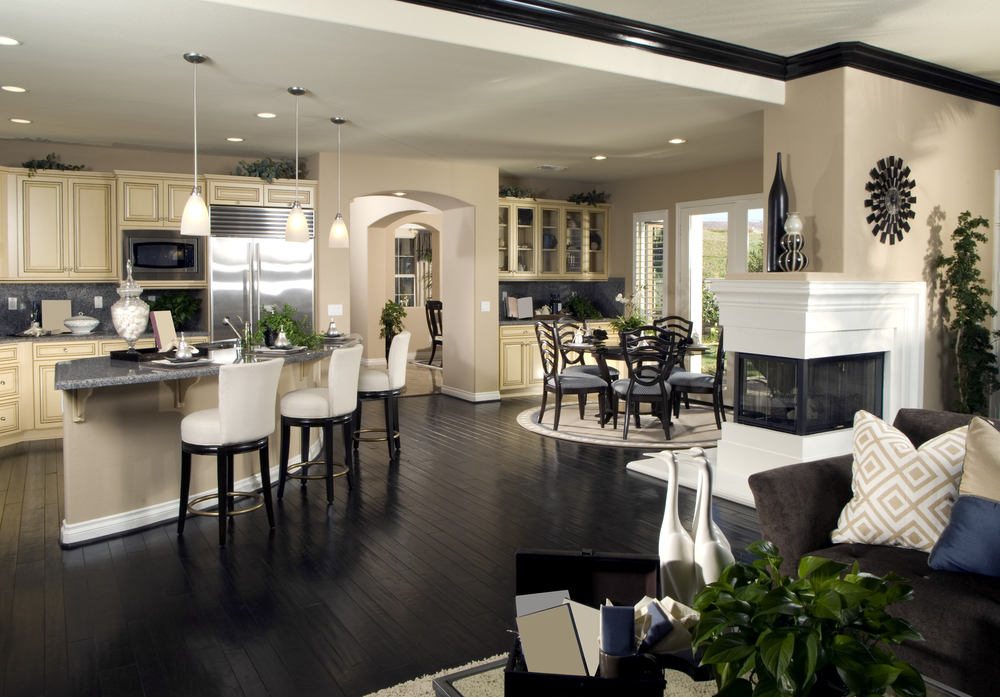 black-wood-floor-feats-leather-bar-stools-in-stunning-open-concept-kitchen-living-room-design-plus-elegant-corner-fireplace